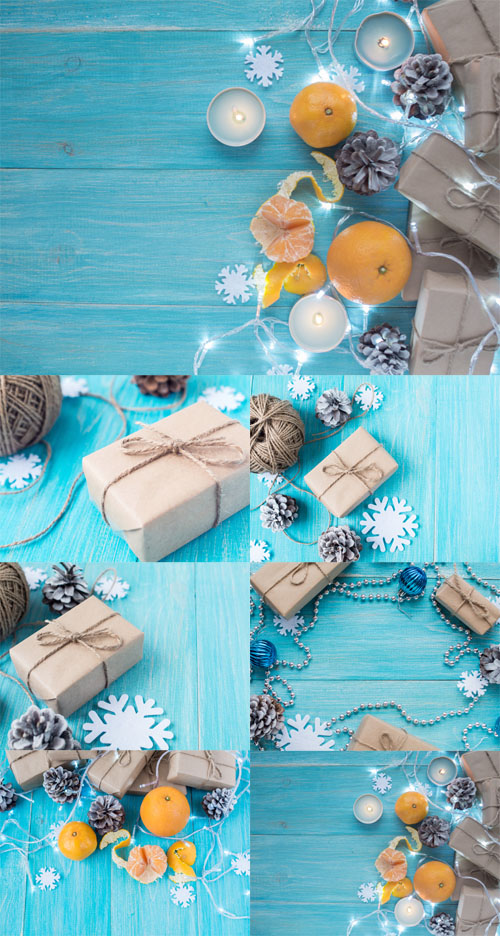 Photo Kraft gift boxes, garland, candles, mandarins , snowflakes, Christmas decorations, cones on the wooden blue