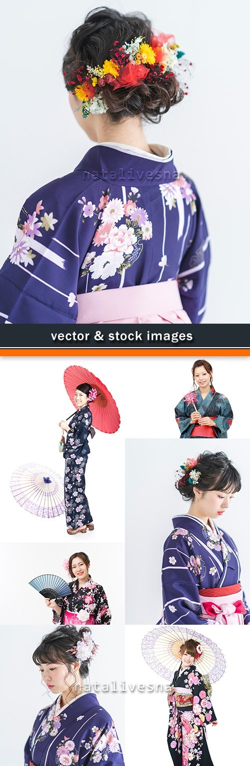 Geisha in kimono with an umbrella and fan and flowers in hair