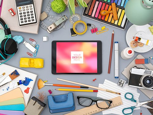 Desk with Tablet and Colorful Art Supplies Mockup 245404736 PSDT