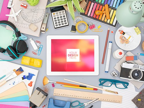 Desk with Tablet and Colorful Art Supplies Mockup 245404447 PSDT