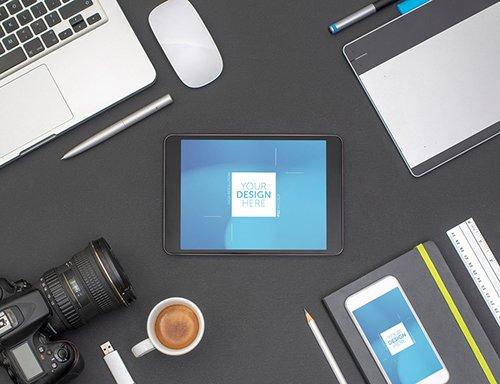 Desk with Tablet, Smartphone, and Camera Mockup 245404658 PSDT