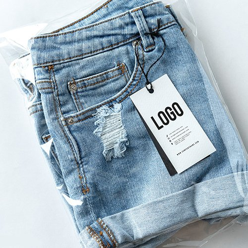 Ripped jean shorts with a tag PSD mockup 531696