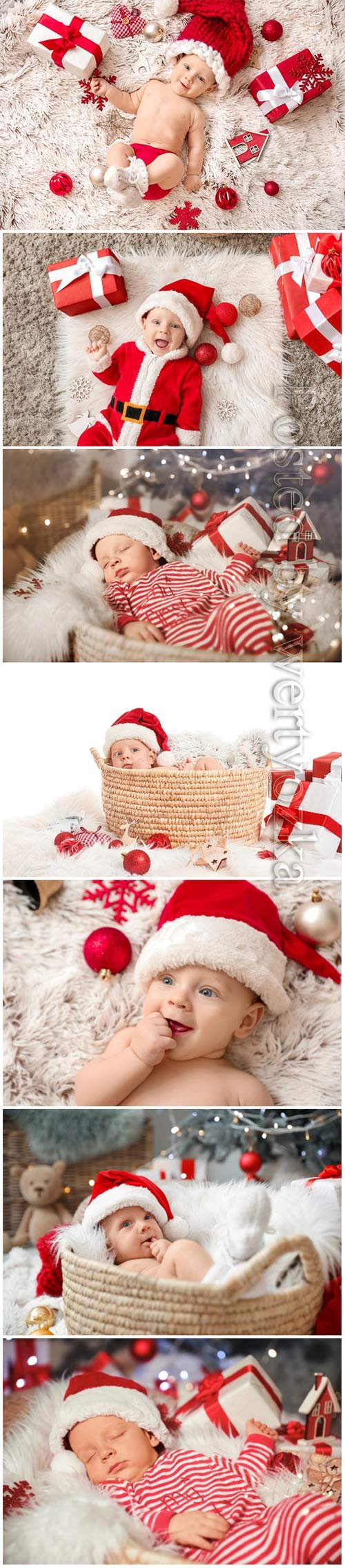 Cute little baby in Santa Claus hat and with Christmas gifts lying on plaid