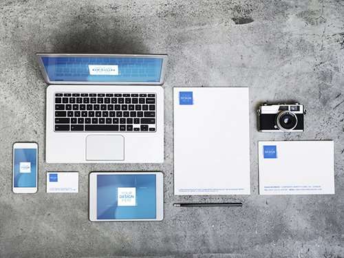 Devices, Laptop, and Stationery on Concrete Background Mockup 1 193482442 PSDT