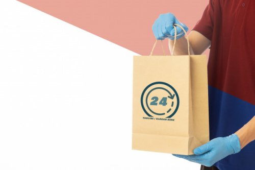 Closeup delivery man hand in medical gloves holding cardboard box mockup