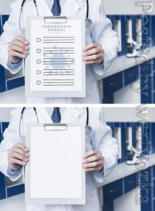 Smiley doctor holding a medical paper mock-up medium shot